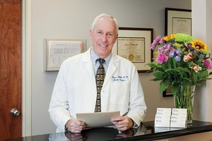 Professional Photograph of James D Wethe, MD in white labcoat in his office