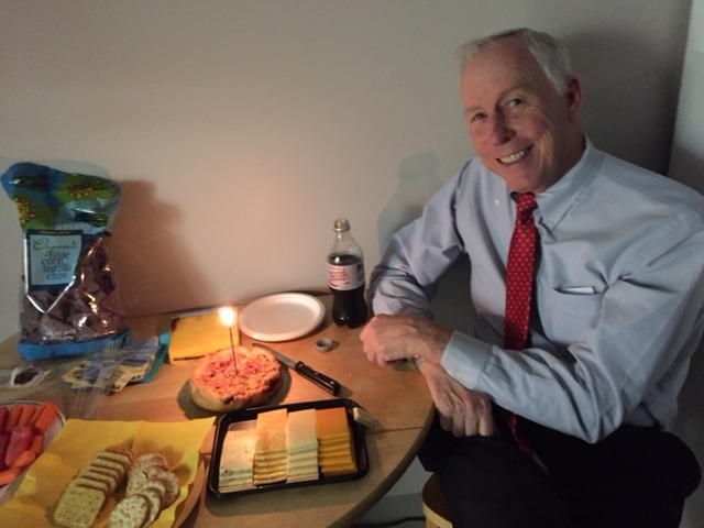 Photo of Dr Wethe enjoying his birthday cake